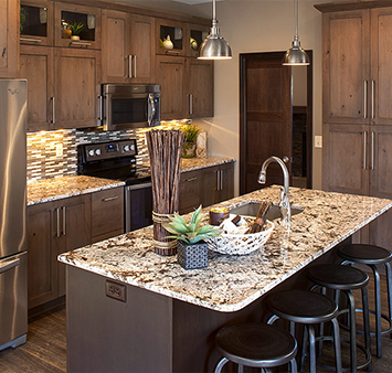 kitchen with dark wood cabinets and quartz countertop