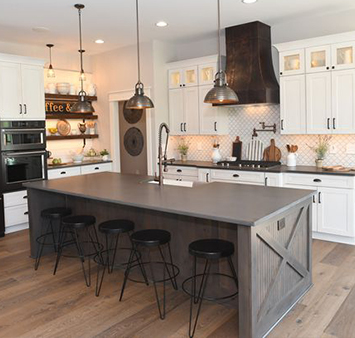 kitchen with painted white cabinets and wood island