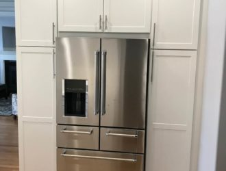 White Painted Kitchen Cabinets around a fridge